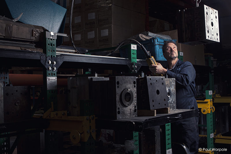 Fastrak Retail Man moving injection mould at Fastrak Paul Worpole Photography
