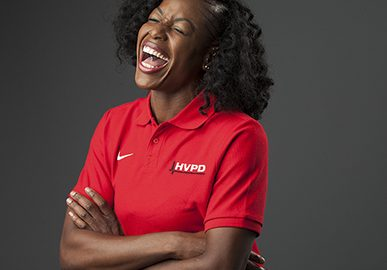 Corporate Photography Manchester Portrait of Woman Laughing in Company Red Uniform © Paul Worpole Photography