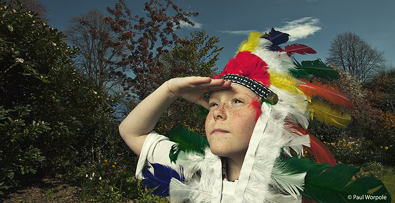 Editorial Photography of Girl in Indian Headress looking into Middle Distance © Paul Worpole Photography