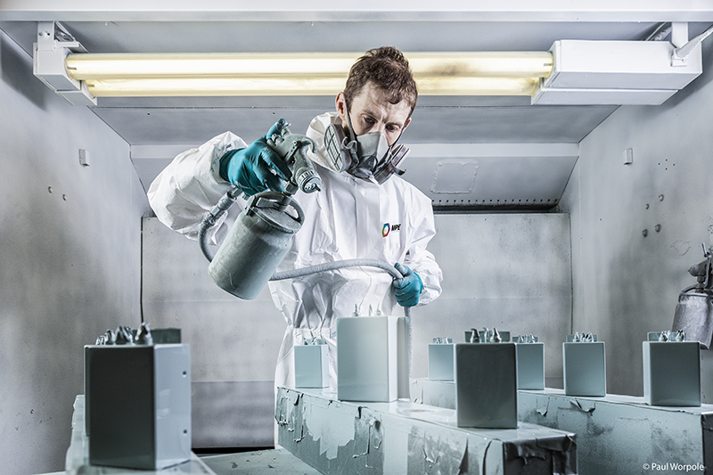 Editorial Photography of man spraying in spray booth © Paul Worpole Photography