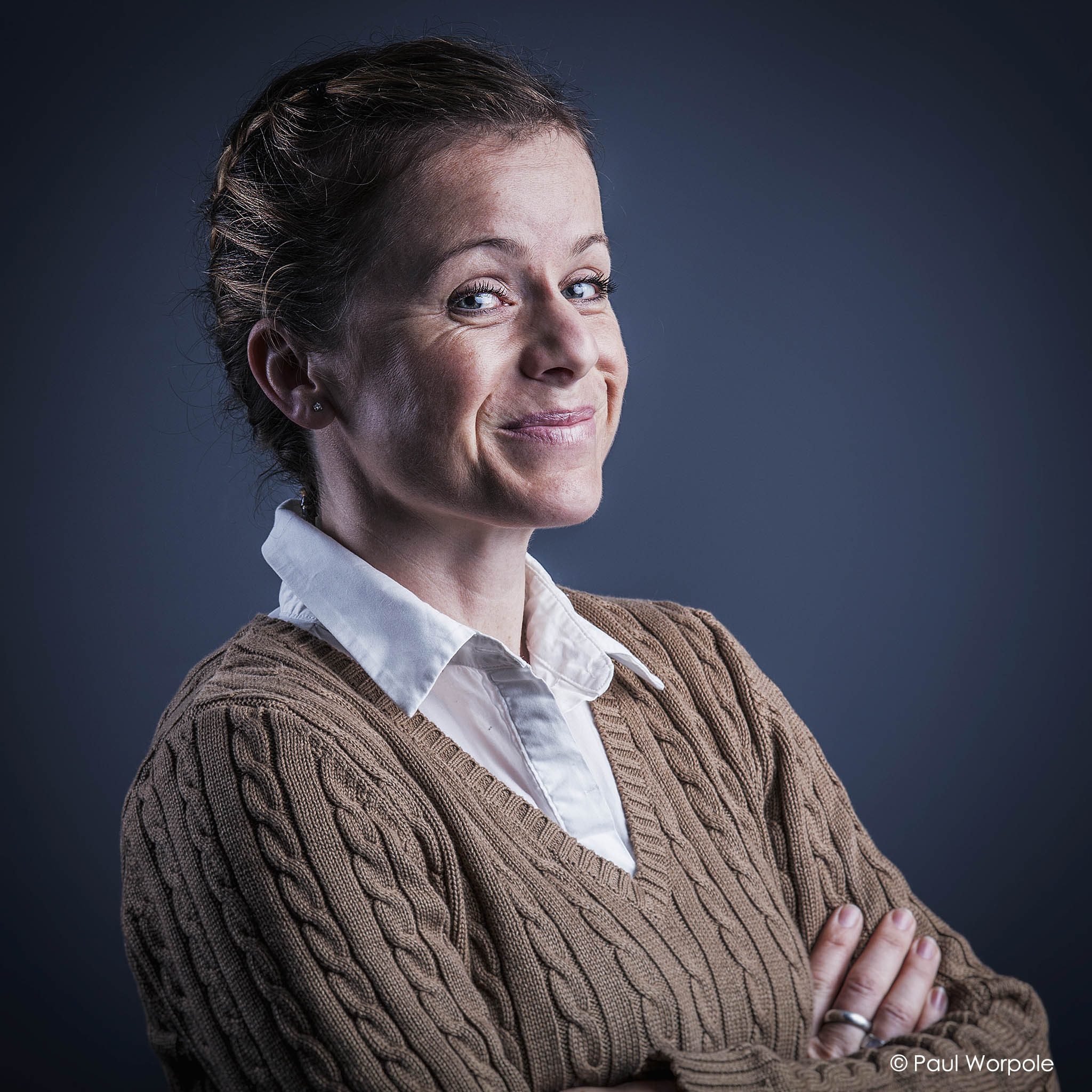 Staff photography of woman smiling with arms folded © Paul Worpole Photography