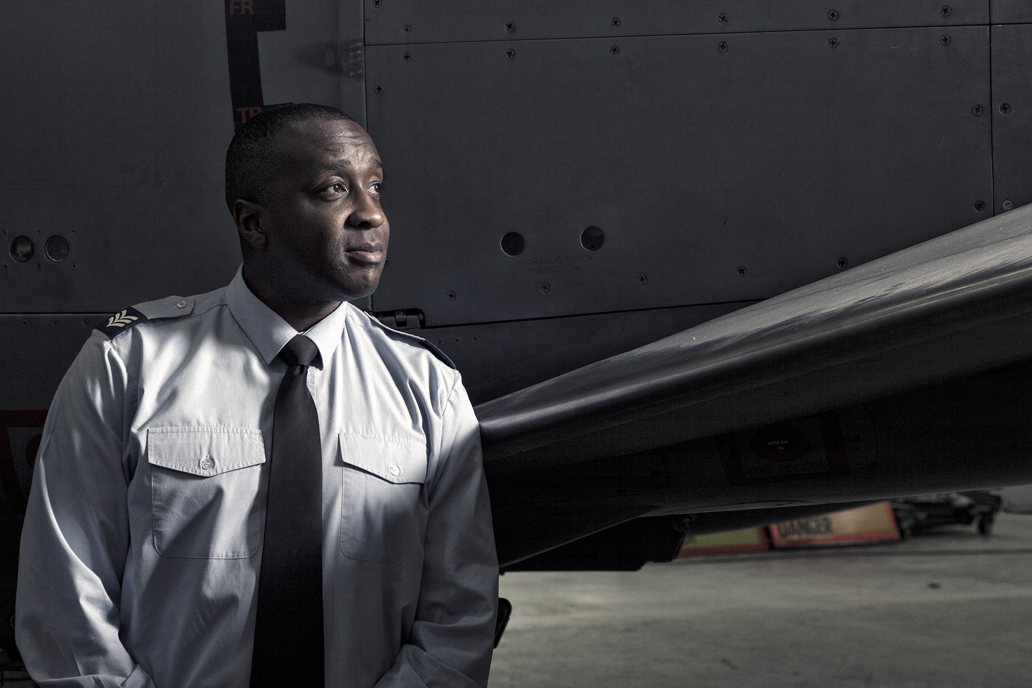 Public Relations Photography of RAF Sergeant next to a wing of a fighter jet © Paul Worpole Photography