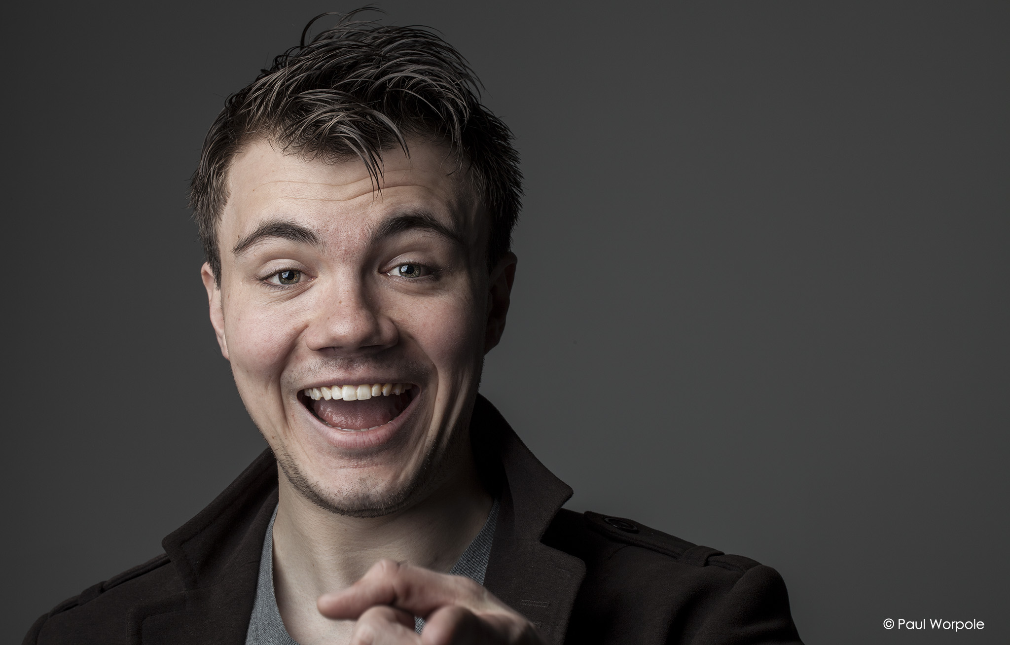 Actor Headshots - portrait of young man pointing at camera laughing © Paul Worpole Photography