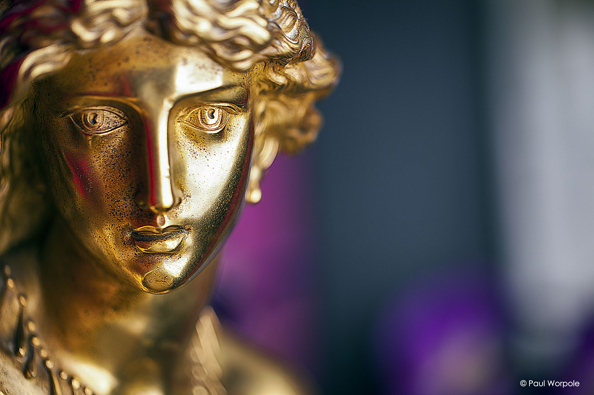 Commercial photography close up face shot of 1920s gold staue © Paul Worpole Photography
