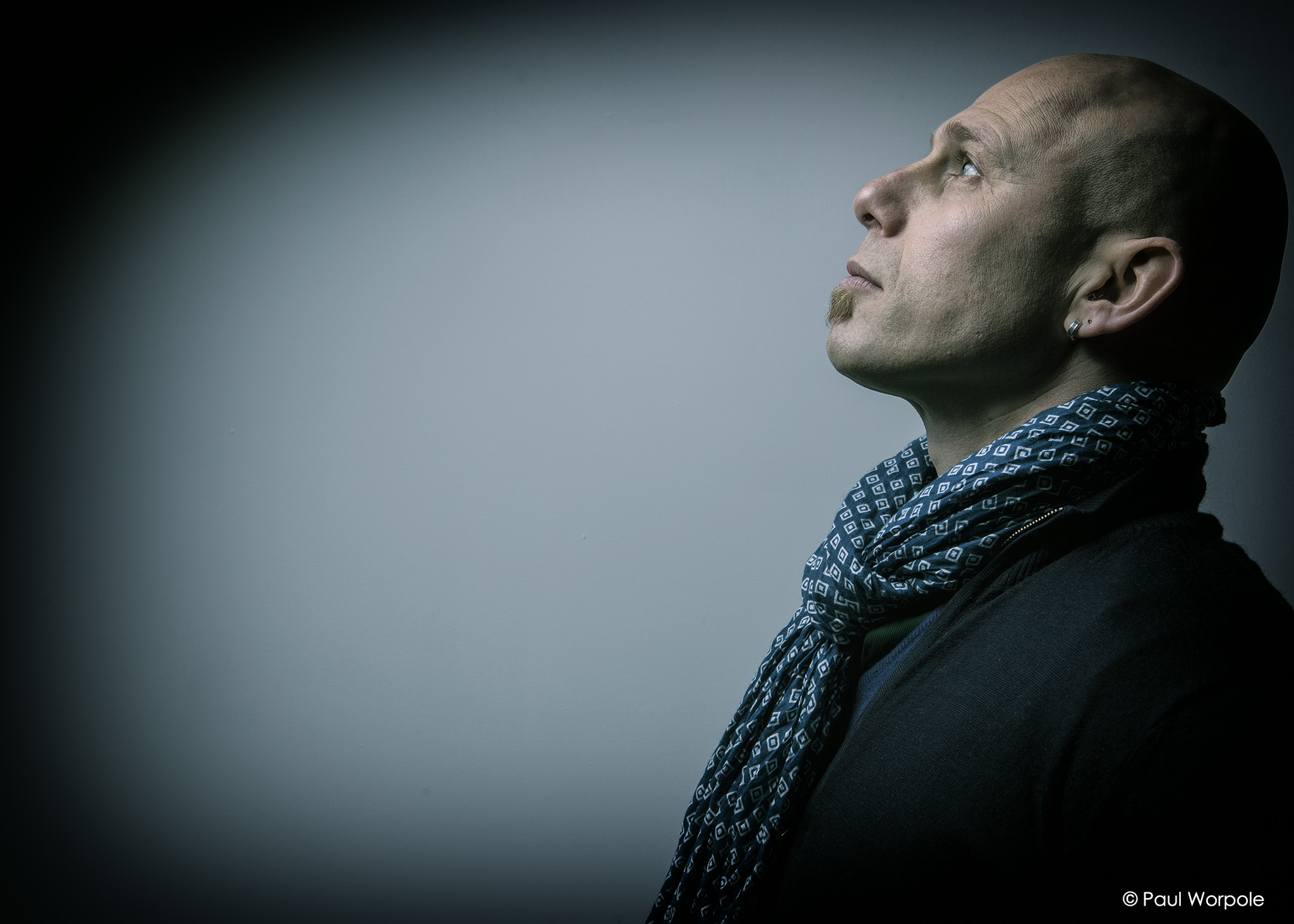Portrait Photography of man in profile looking up at 45 degrees with silk scarf © Paul Worpole Photography