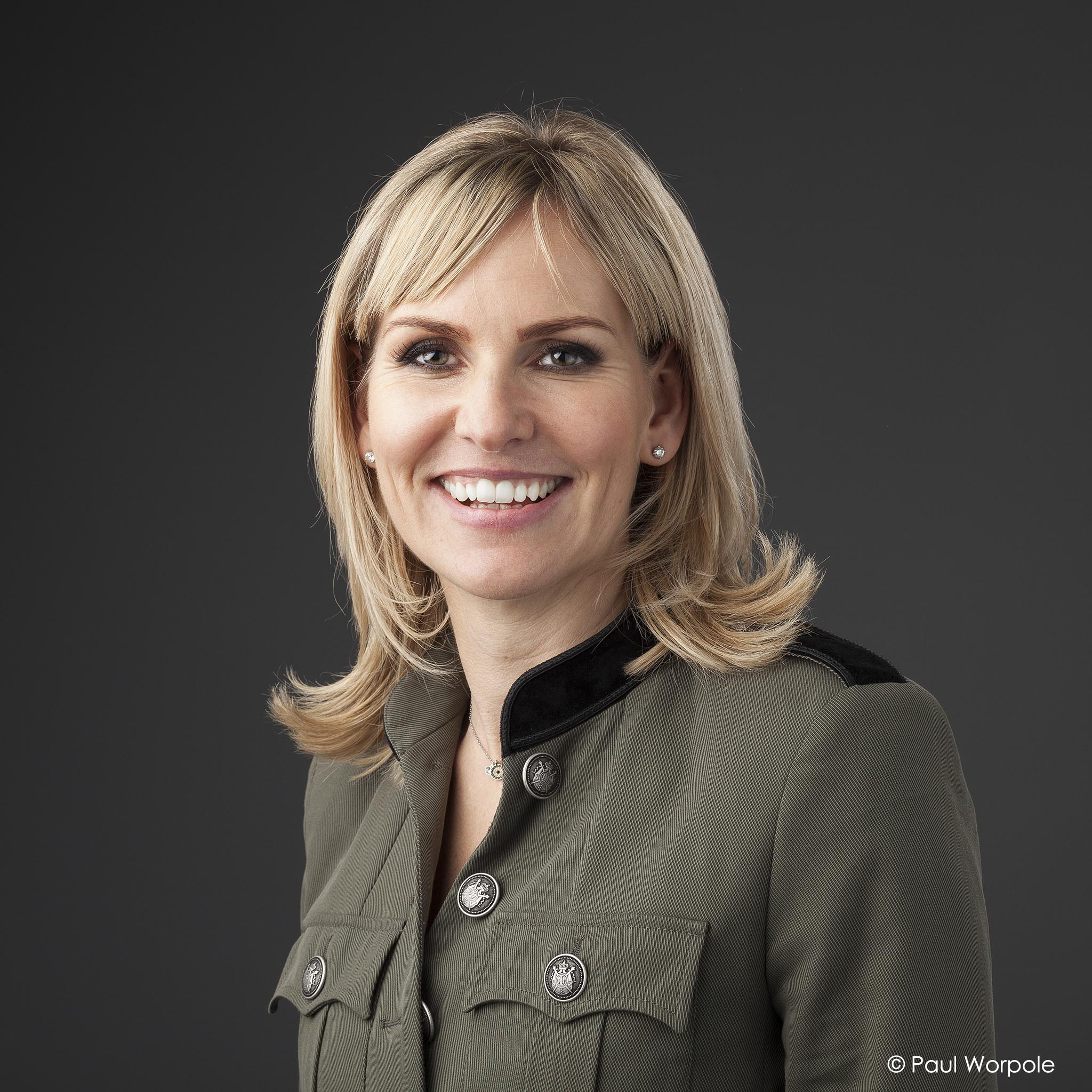 Portrait Photography of woman in grey military style jacket Paul Worpole Photography