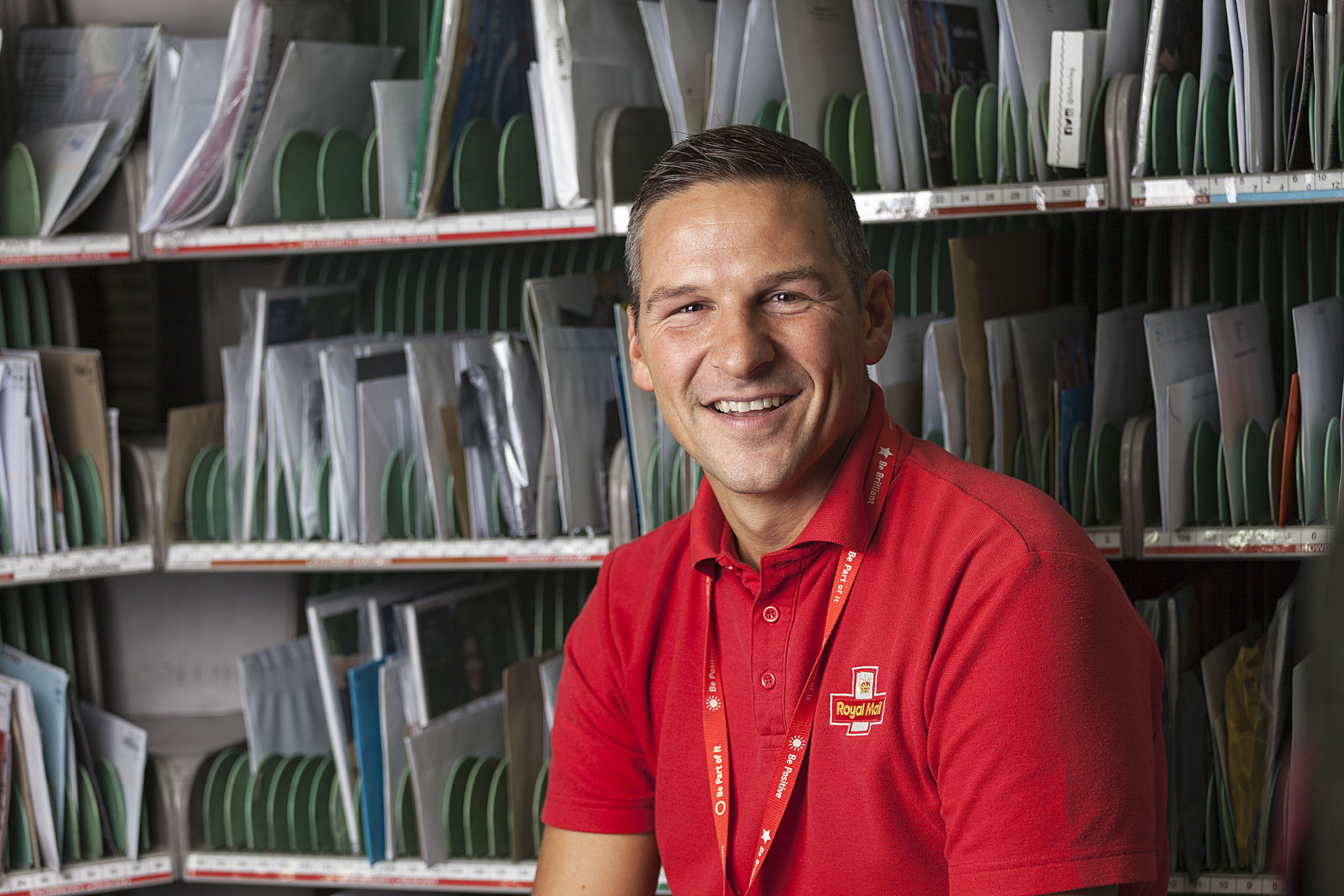 PR Photography of Royal Mail employee in sorting office © Paul Worpole Photography