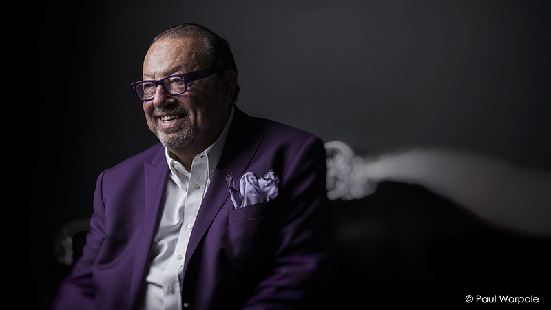 Staff Headshot Portrait of a man with a beard and purple suit and purple glasses on © Paul Worpole Photography