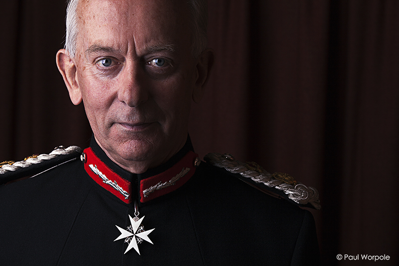Staff Headshots portrait of a man in ceremonial uniform with maltese cross © Paul Worpole Photography