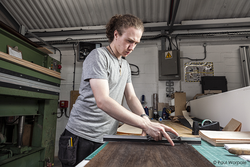 Man hand Cutting Laminate at British Drum Co © Paul Worpole Photography