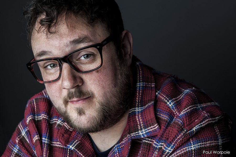 Actor Headshots - man in checked shiet with glasses © Paul Worpole Photography
