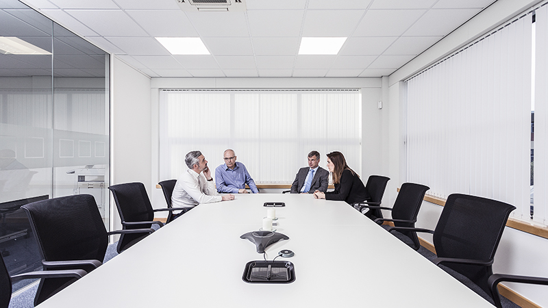 Four people sitting around a boardroom table10 Essential photographs that every company should have in their portfolio. © Paul Worpole Photography