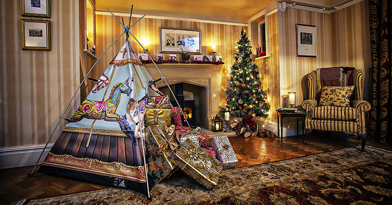 Tent in a room with Christmas presnts 10 Essential photographs that every company should have in their portfolio. © Paul Worpole Photography