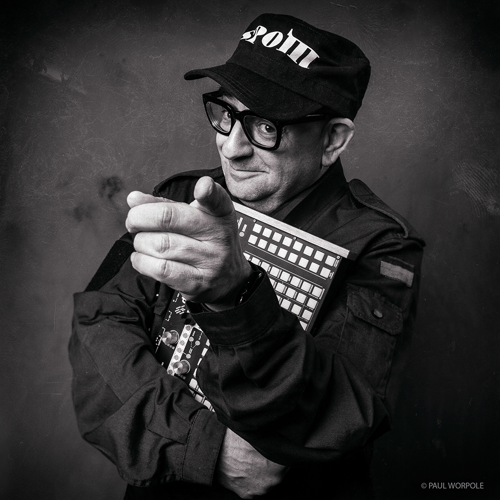 Portrait of man pointing with Baseball Cap © Paul Worpole Photography