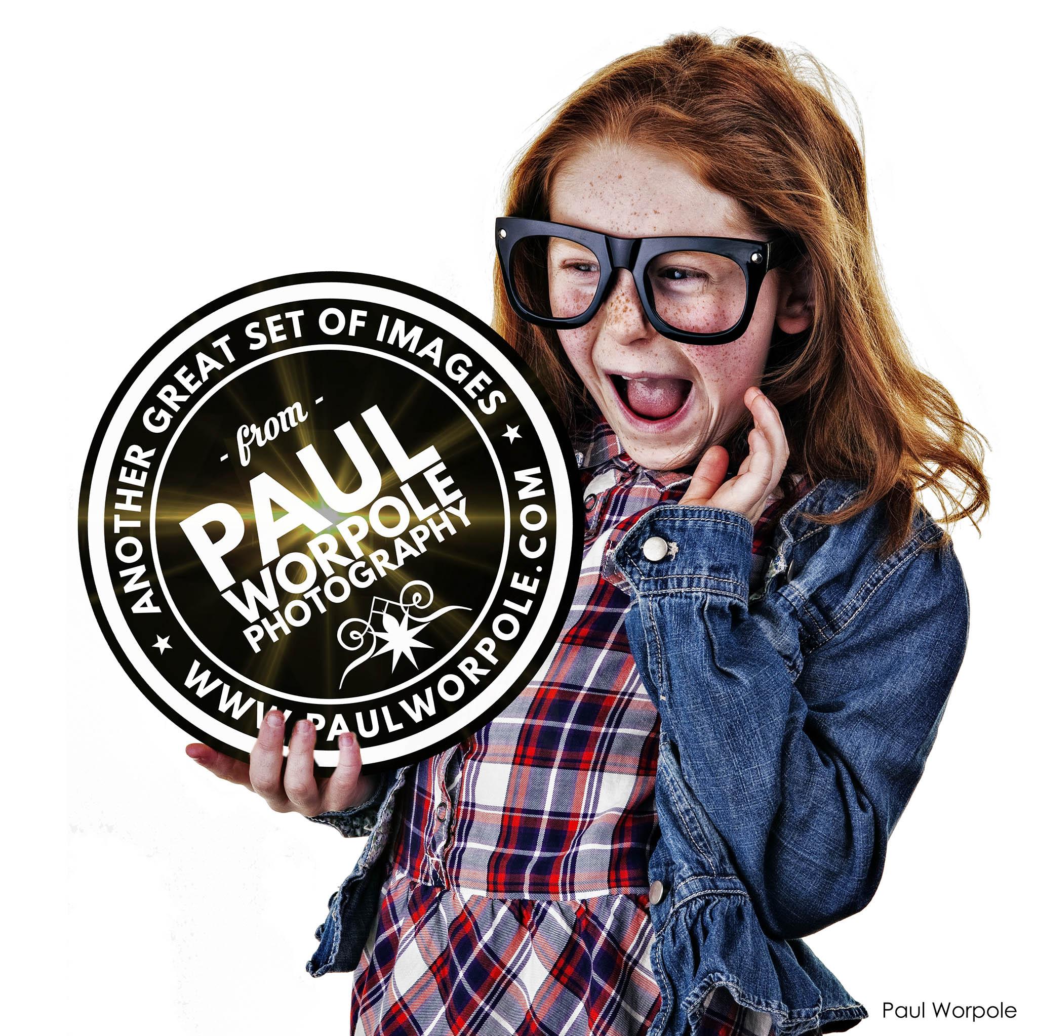 Child with Big Glasses Holding Award
